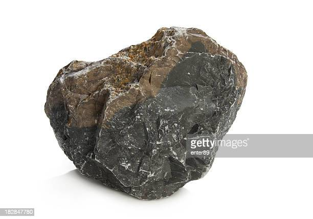 A solid dark rock on a white background