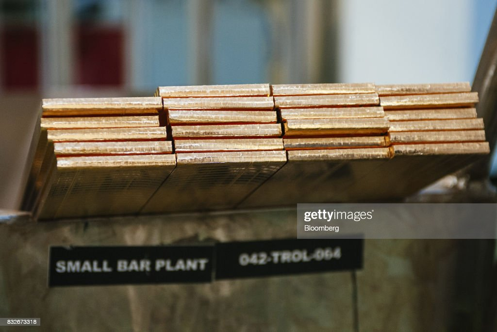 Solid gold lengths sit in piles before use at the Rand Refinery Ltd. plant in Germiston, South Africa, on Wednesday, Aug. 16. 2017. Established by the Chamber of Mines of South Africa in 1920, Rand Refinery is the largest integrated single-site precious metals refining and smelting complex in the world, according to their website. Photographer: Waldo Swiegers/Bloomberg via Getty Images