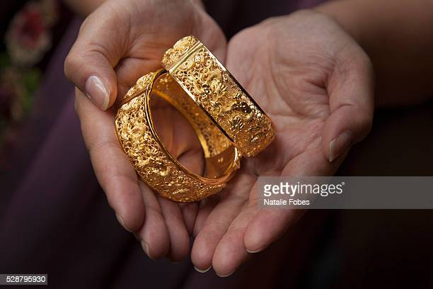 solid gold wedding bracelets with chinese character for luck - jewellery stock pictures, royalty-free photos & images