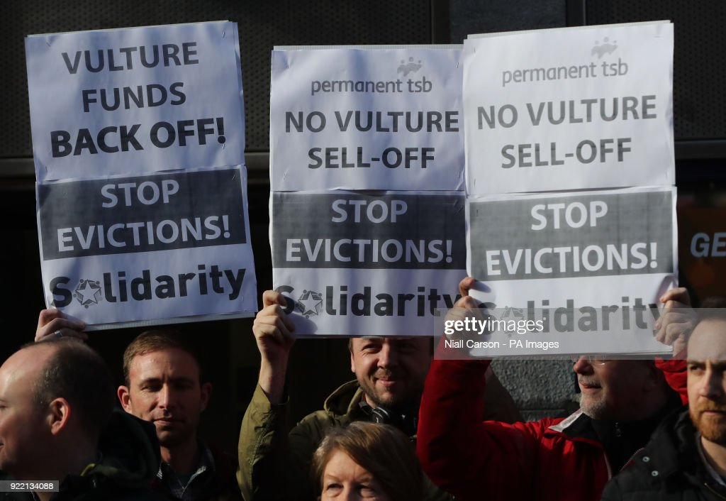 Solidarity activists hold a protest in opposition to the sale of millions of euro worth of mortgages to vulture funds outside the Grafton Street branch of Permanent TSB bank in Dublin.
