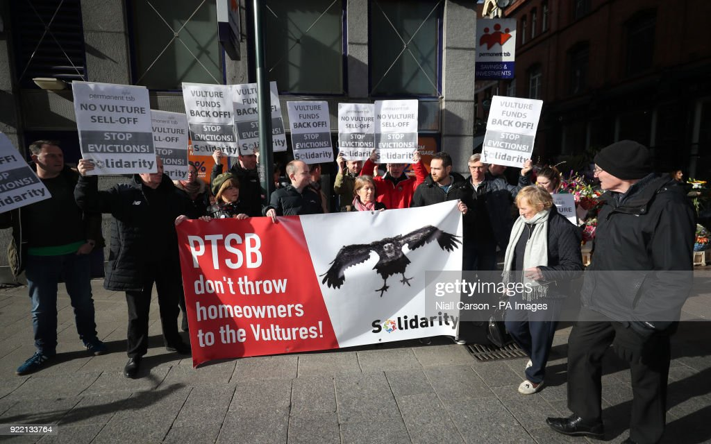 Solidarity TDs and activists hold a protest in opposition to the sale of millions of euro worth of mortgages to vulture funds outside the Grafton Street branch of Permanent TSB bank in Dublin.