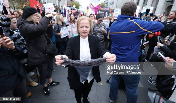 SolidarityETHPeople Before Profit TD Ruth Coppinger holds a thong during a protest in support of victims of Sexual violence on O'Connell Street Dublin