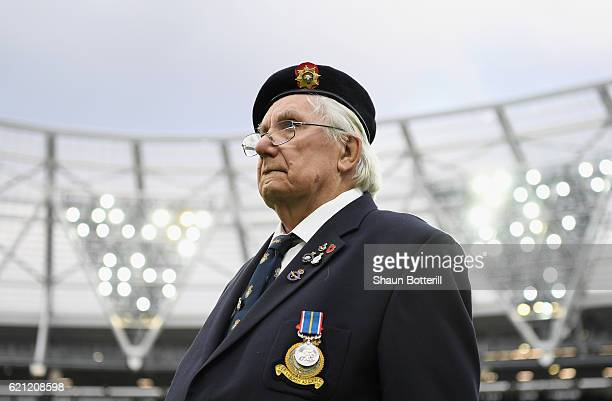 A solider looks on prior to kick off during the Premier League match between West Ham United and Stoke City at Olympic Stadium on November 5 2016 in...