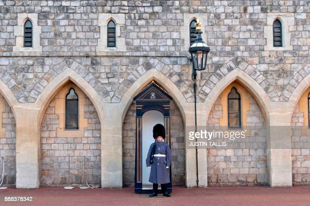 A solider stands on guard duty inside the grounds of Windsor Castle in Windsor west of London on December 8 2017 Britain's Prince Harry will marry...