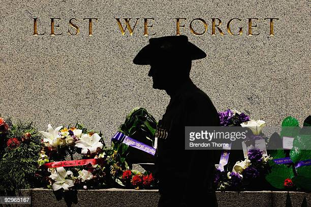 A solider stands silent next to the Cenotaph during the 91st Anniversary Remembrance Day Service at the Cenotaph Martin Place on November 11 2009 in...