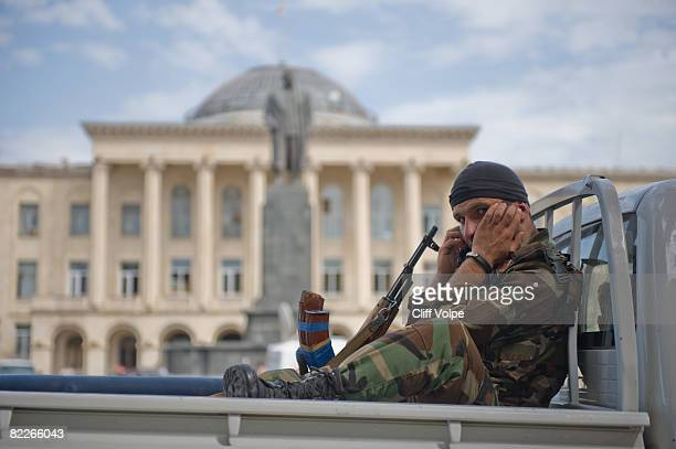A solider talks on his mobile phone in front of a statue of Joseph Stalin in the main square August 11 2008 in Gori Georgia Stalin was born in Gori...