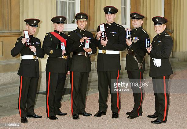 Soliders from the Mercian Regiment Corporal Mark Ward with his Military Cross Warrant Officer Anthony Higginbottom with his MBE Major Richard Grover...