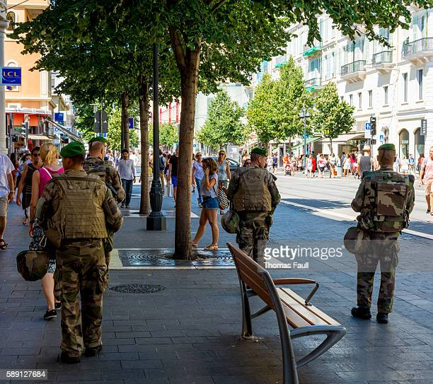 soliders on the streets of nice, france after terrorist attack - french foreign legion photos et images de collection