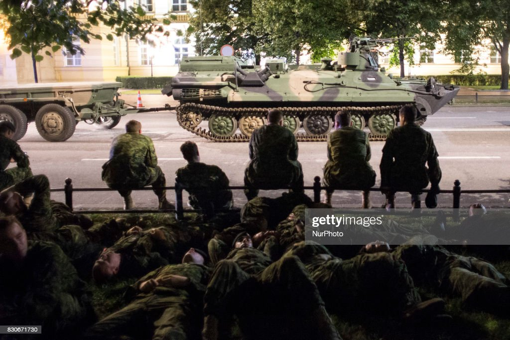 Soliders rest during night training before parade on Polish Army Day in Warsaw on August 12, 2017.