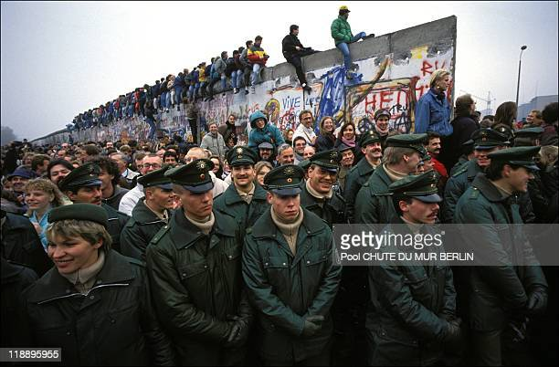 Soliders stand during the opening of the Berlin wall on November 12, 1989 in Berlin, Germany.