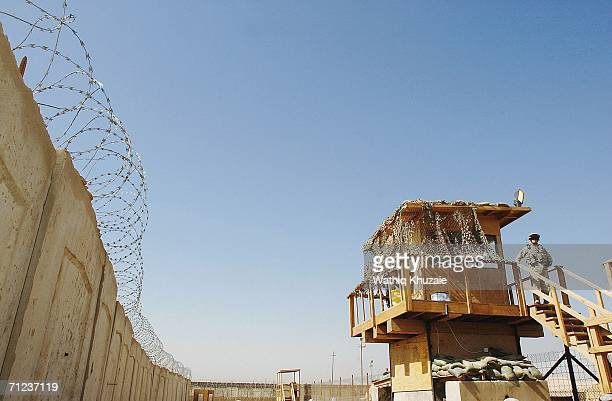 S soliders stand guard on June 19 2006 at Abu Ghraib prison west of Baghdad Iraq More than 300 detainees were released on June 19 2006 from Abu...