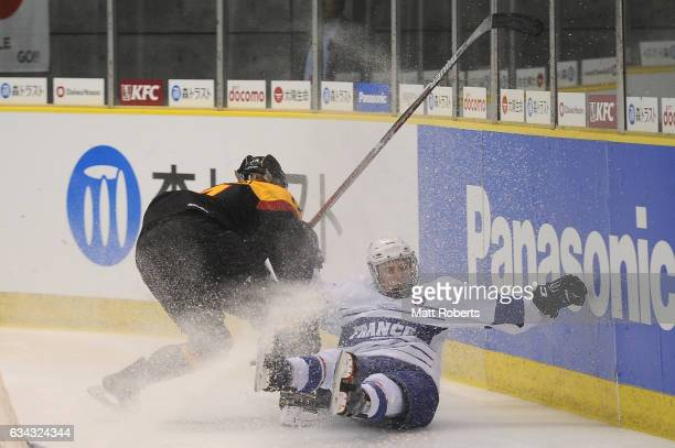 Soline Forher of France and Carina Strobel of Germany battle for the puck during the Women's Ice Hockey Olympic Qualification Final game between...