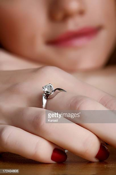 solitaire engagement ring - animal finger stock photos and pictures
