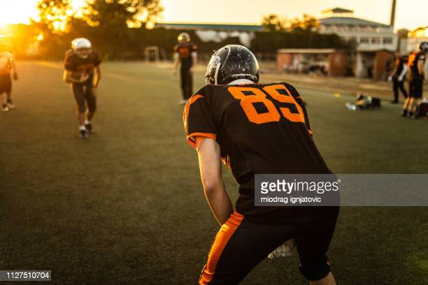 solitary american football player - sports jersey stock pictures, royalty-free photos & images