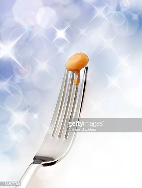Solitary baked bean on a fork