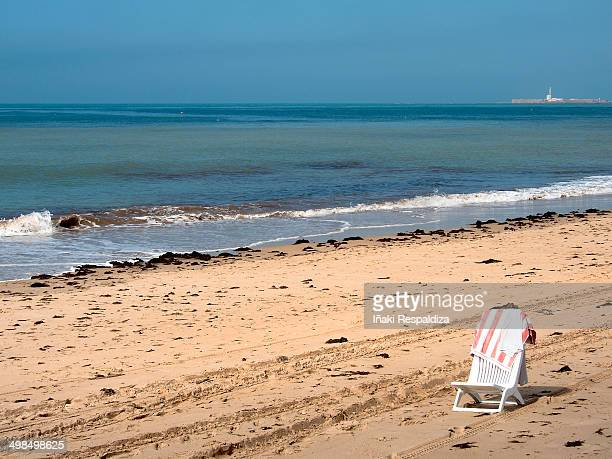 solitary beach - iñaki respaldiza stock pictures, royalty-free photos & images