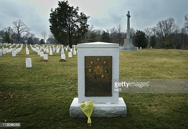 ARLINGTON VA A solitary bouquet of flowers rests on the Space Shuttle Challenger memorial at Arlington National Cemetary Saturday morning February 1...