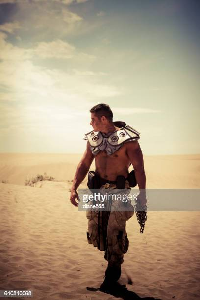 Solitary Futuristic Soldier Walks Through The Desert