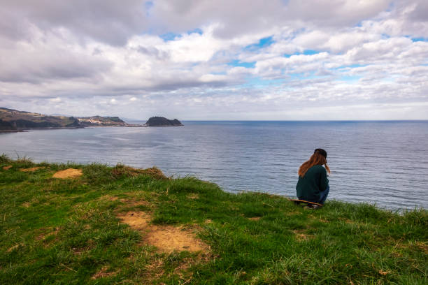 A solitary girl in front of the sea