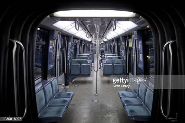 Solitary passenger sits in an empty Metro train as a city wide curfew comes into effect throughout Paris on October 17, 2020 in Paris, France. The...