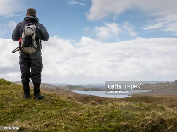 Solitary walker at llyn Egnant, Ceredigion. The Cambrian Way, Wales, UK