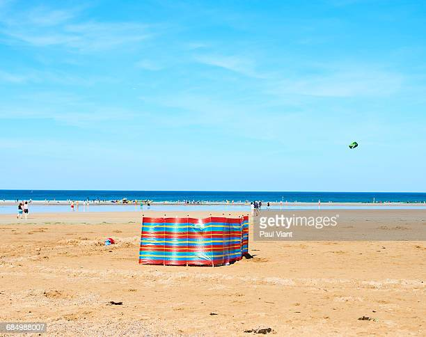 solitary windbreak on sandy beach - windbreak stock pictures, royalty-free photos & images