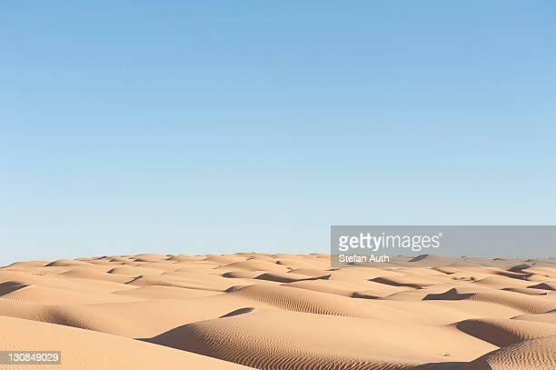 Solitude, blue sky, sand dunes, Sahara desert between Douz and Ksar Ghilane, Southern Tunisia, Tunisia, Maghreb, North Africa, Africa