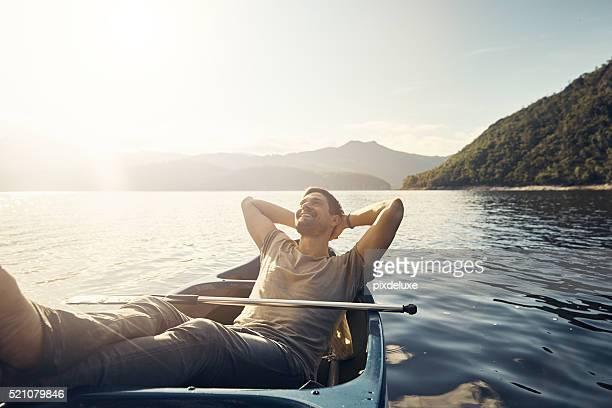 solitude in nature is bliss - small boat stock pictures, royalty-free photos & images