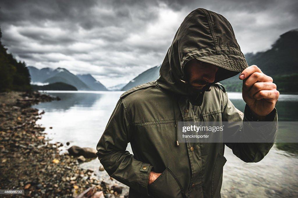 Solitude man pensive on the lake side : Stock Photo