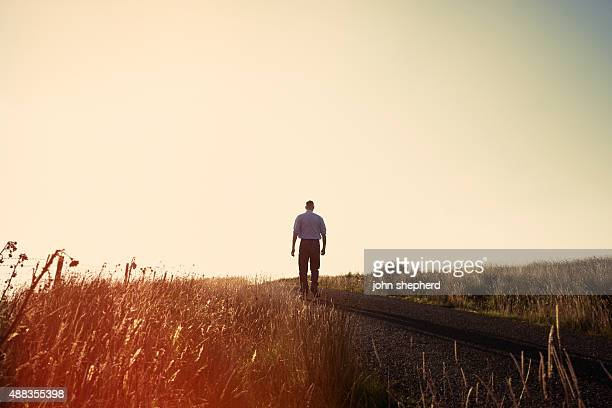 Solitude, Man stood alone on a country road