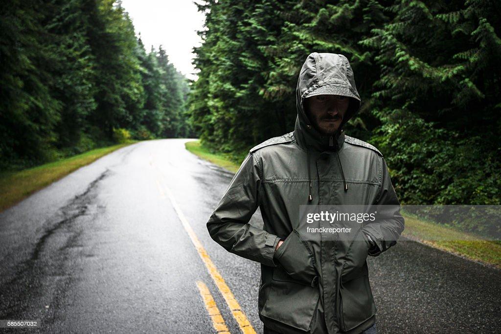 Solitude man walking on the street in British columbia : Stock Photo