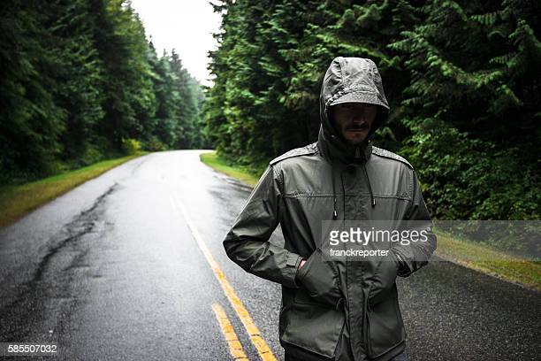 solitude man walking on the street in british columbia - parka coat stock photos and pictures