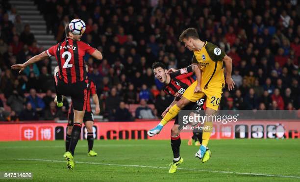 Solly March of Brighton and Hove Albion beats Adam Smith of AFC Bournemouth to score their first goal during the Premier League match between AFC...