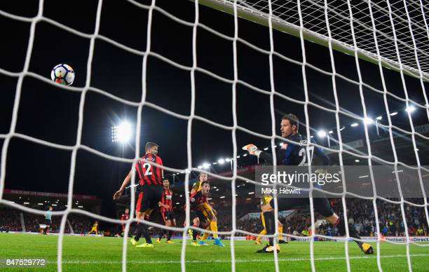 Solly March of Brighton and Hove Albion beats goalkeeper Asmir Begovic of AFC Bournemouth to score their first goal during the Premier League match...