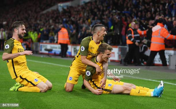 Solly March of Brighton and Hove Albion celebrates as he scores their first goal with team mate Anthony Knockaert during the Premier League match...