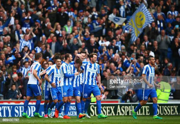 Solly March of Brighton and Hove Albion celebrates scoring his team's second goal with team mates during the Sky Bet Championship match between...