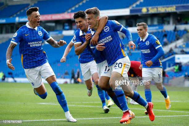 Solly March of Brighton and Hove Albion celebrates with teammate Steven Alzate after scoring his team's second goal during the Premier League match...