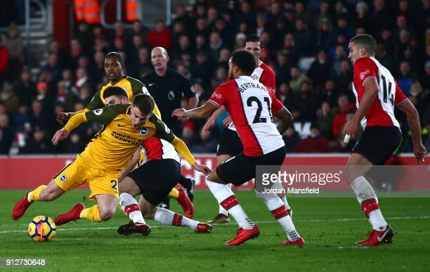 Solly March of Brighton and Hove Albion is fouled by Wesley Hoedt of Southampton for which a penalty is awarded by referee Mike Dean during the...