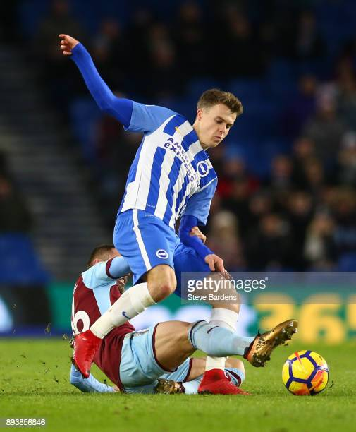 Solly March of Brighton and Hove Albion is tackled by Phil Bardsley during the Premier League match between Brighton and Hove Albion and Burnley at...