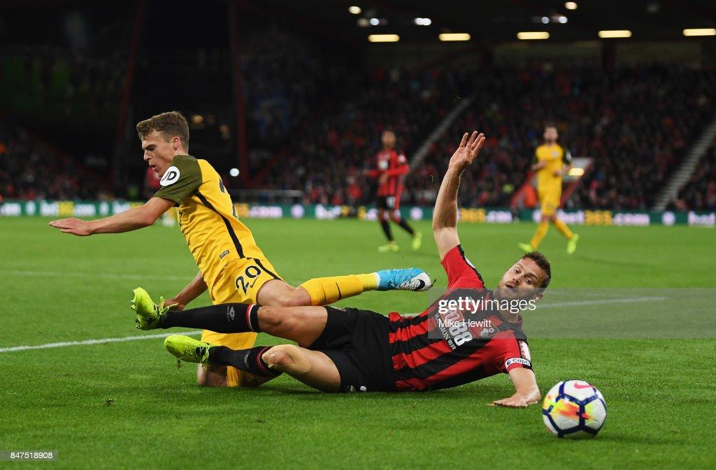 Solly March of Brighton and Hove Albion is tackled by Simon Francis of AFC Bournemouth during the Premier League match between AFC Bournemouth and Brighton and Hove Albion at Vitality Stadium on September 15, 2017 in Bournemouth, England.