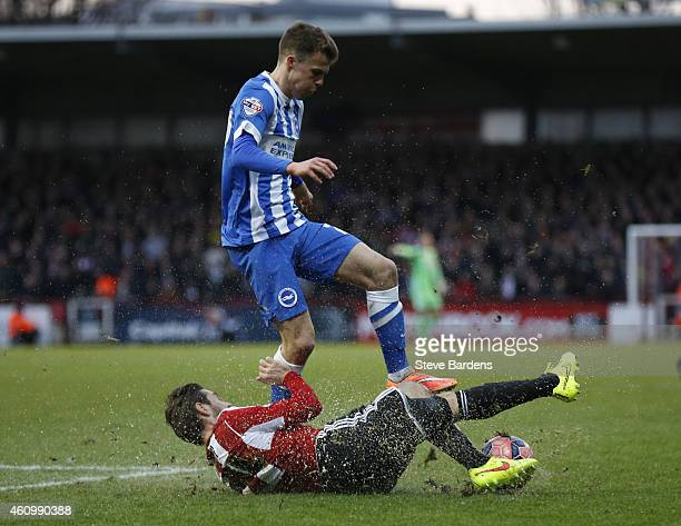 Solly March of Brighton Hove Albion is tackled by Tommy Smith of Brentford during the FA Cup Third Round match between Brentford v Brighton Hove...