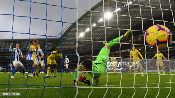 Solly March of Brighton scores despite the efforts of Kepa Arrizabalaga of Chelsea during the Premier League match between Brighton Hove Albion and...