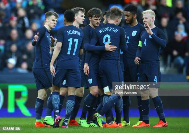 Solly March of England celebrates as scores their second goal with team mates during the U21 international friendly match between Denmark and England...
