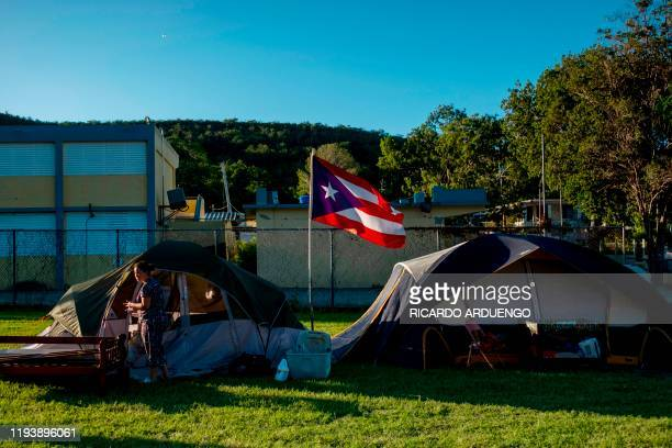 Solmely Velazquez stands in front of her tent in a baseball field in Guanica Puerto Rico on January 15 after a powerful earthquake hit the island The...