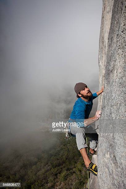 Solo Climber Ascends Rock Wall