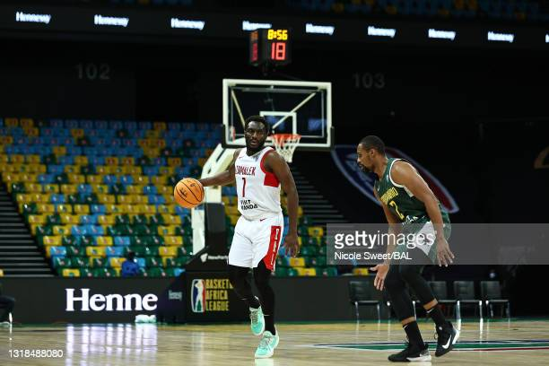 Solo Diabate of Zamalek brings the ball up court against Hugo Martins of Ferroviáro de Maputo during the first half at Kigali Arena on May 17, 2021...