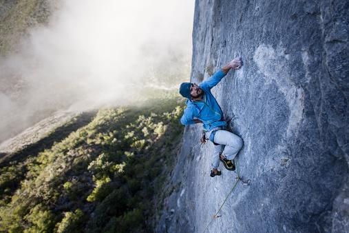 Solo Guy Climbs Rock Wall - gettyimageskorea