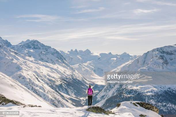 solo hiker woman admire the alpine landscape - swiss alps stock pictures, royalty-free photos & images