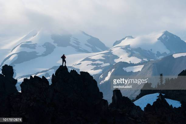 solo hiking adventure in the mountains - whistler british columbia stock pictures, royalty-free photos & images