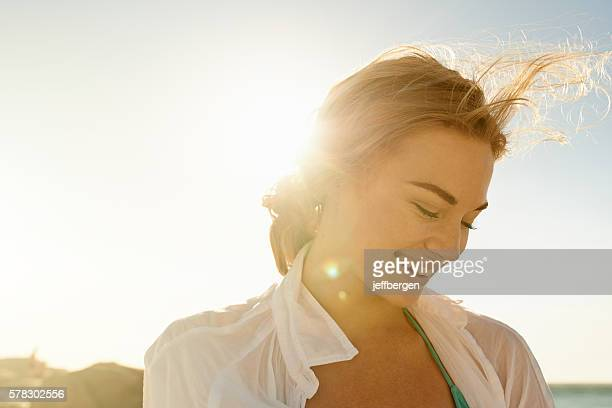 solo in the sun - candid beach stock photos and pictures